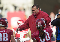 Hawgs Illustrated/BEN GOFF <br /> Bret Bielema, Arkansas head coach, greets players during warmups before the game against Missouri Friday, Nov. 24, 2017, at Reynolds Razorback Stadium in Fayetteville.