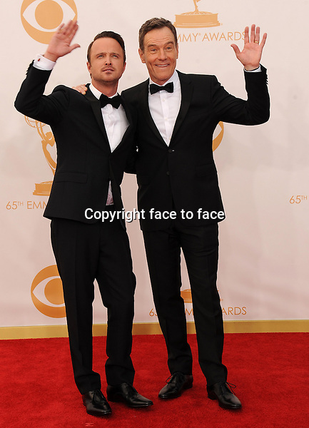 Aaron Paul and Bryan Cranston arrive at the 65th Primetime Emmy Awards at Nokia Theatre on Sunday Sept. 22, 2013, in Los Angeles.<br />
