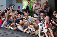 Rihanna gets swarmed by a mob of fans at Antwerp hotel in Belgium