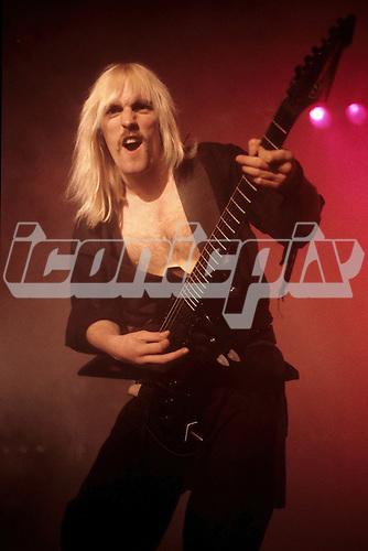 VENOM - guitarist Jeffrey 'Mantas' Dunn - performing live at Les Ambassadeurs in Zurich Switzerland - 1984.  Photo credit: Joseph Carlucci/Dalle/IconicPix