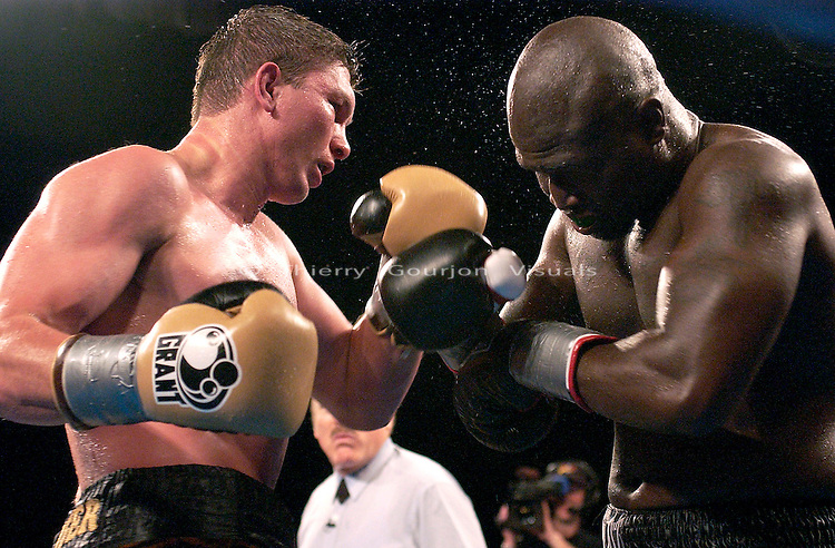 Vassiliy Jirov (left) on the attack against his opponent James Toney during the IBF Cruiserweight Championship at the Foxwoods Casino in Mashantucket, Connecticut on April 26, 2003. James Toney won the fight by Unanimous decision.