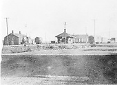 D&amp;RG Antonito station area showing depot, engine house and freight house, looking south.  A string of cars is on the westbound siding while an engine sits beside the engine house along the Santa Fe Branch lead.<br /> D&amp;RGW  Antonito, CO  Taken by Joyce, W. D. - ca. 1910-1920