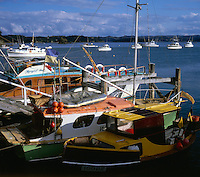 Fishing boats and pleasure crafts tied to jetty in Russell, Bay of Islands, New Zealand, 1980