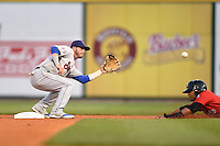 Tennessee Smokies second baseman Stephen Bruno (11) takes a throw on a steal attempt during a game against the Birmingham Barons on April 22, 2014 at Regions Field in Birmingham, Alabama.  Birmingham defeated Tennessee 14-3.  (Mike Janes/Four Seam Images)