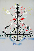 A mythological symbol from the Afro-Cuban religious tradition drawn on the wall of the African Culture Heritage Centre in Santiago de Cuba, Cuba, August 4, 2009. The Palo religion (Las Reglas de Congo) belongs to the group of syncretic religions which developed in Cuba amongst the black slaves, originally brought from Congo during the colonial period. Palo, having its roots in spiritual concepts of the indigenous people in Africa, worships the spirits and natural powers but can often give them faces and names known from the Christian dogma. Although there have been strong religious restrictions during the decades of the Cuban Revolution, the majority of Cubans still consult their problems with practitioners of some Afro Cuban religion.