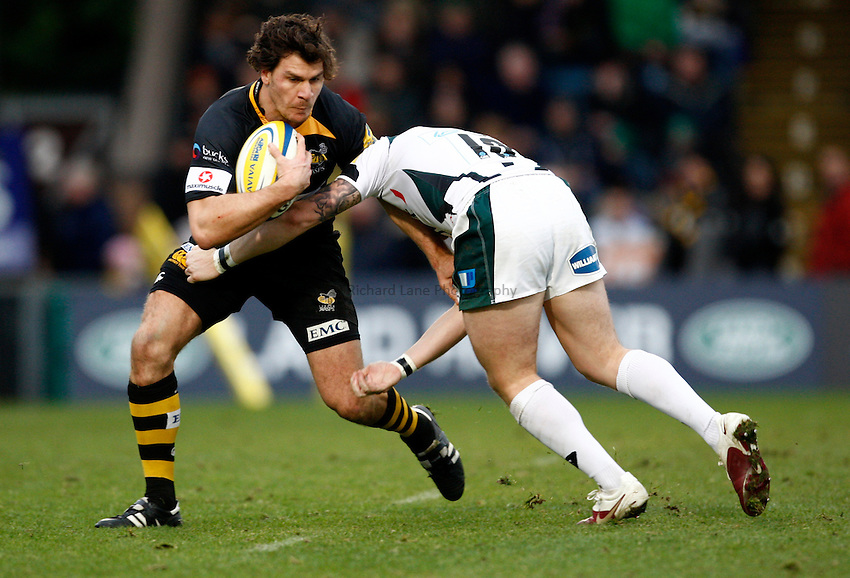 Photo: Richard Lane/Richard Lane Photography.London Wasps v London Irish. Aviva Premiership. 21/11/2010. Wasps' Ben Jacobs is tackled  by Irish's Ryan Lamb.