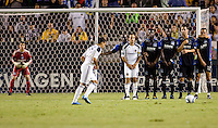 LA Galaxy midfielder Juninho (16) attempts a shot in front of a San Jose Earthquakes wall consisting of LA Galaxy midfielder Landon Donovan (10), Brandon McDonald (14), Ike Opara (6), Bobby Burling (2) and Ramiro Corrales (12). The LA Galaxy and the San Jose Earthquakes played to a 2-2 draw at Home Depot Center stadium in Carson, California on Thursday July 22, 2010.