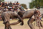 Sunday 5 december 2010 - Juba, Southern Sudan - Traditional wrestling matches in Juba Stadium between Dinka wrestlers from Yirol East of Lake State and Mundari wrestlers from Terekeka County of Central Equatoria State. The matches attracted large numbers of spectators who sang, played drums and danced in support of their favorite wrestlers. The match organizers hoped that the sport would bring together South Sudan's many different tribes. Photo credit: Benedicte Desrus