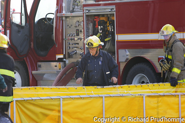 fireman keeping an eye on water holdong tank at the scene of a fire