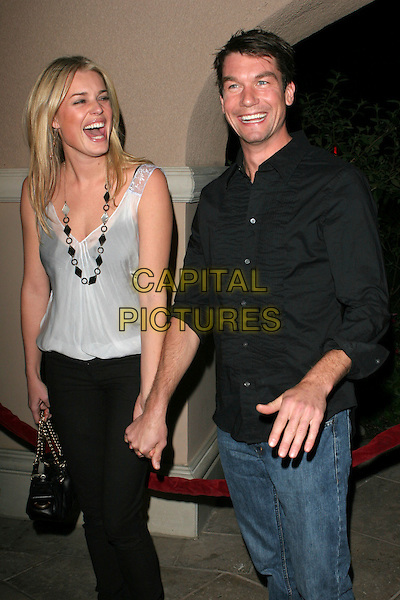 REBECCA ROMIJN & JERRY O'CONNELL.NBC 2006 TCA Winter Press Tour Party - Arrivals held at the Ritz Carlton,Pasadena, California..January 22nd, 2006.Photo: Zach Lipp/AdMedia/Capital Pictures.Ref: ZL/ADM.half length black trousers white top jeans denim shirt holding hands celebrity couple laughing smiling.www.capitalpictures.com.sales@capitalpictures.com.© Capital Pictures.