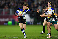 Rhys Priestland of Bath Rugby looks to fend Kieran Brookes of Northampton Saints. Aviva Premiership match, between Bath Rugby and Northampton Saints on February 10, 2017 at the Recreation Ground in Bath, England. Photo by: Patrick Khachfe / Onside Images
