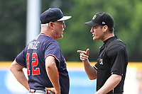 Manager Randy Ingle (12) of the Rome Braves has a discussion with home plate umpire Darrell Roberts in game one of a doubleheader against the Greenville Drive on Tuesday, May 30, 2017, at Fluor Field at the West End in Greenville, South Carolina. Rome won, 10-7. (Tom Priddy/Four Seam Images)
