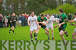 Mikey Brennan (Churchill) in action with Deaglán O'Suillabháin and Pádraig J O'Suilleabháin (Piarsaigh Na Dromada) on Saturday in the Castleisland Mart County Junior Football Championship  at Churchill GAA grounds.