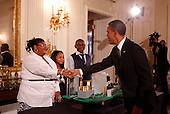 "United States President Barack Obama greets Jayla Mae Dogan, Ashley Cassie Thomas, and  Lucas Cain Beal, all aged 13, of Detroit, Michigan, who are part of a team who focused on designing a city around the theme of ""Fuel Your Future: Imagine New Ways to Meet Our Energy Needs and Maintain a Healthy Planet,""  while touring student science fair projects on exhibt at the White House in Washington, D.C. on February 7, 2012.  Obama hosted the second White House Science Fair celebrating the student winners of science, technology, engineering and math (STEM) competitions from across the country. .Credit: Molly Riley / Pool via CNP"