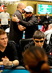 Darren Judges consoles Team PokerStars  PRO Australia Tony Hachem after busting him on Day 2.