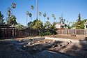 The concrete border of a house foundation remains after demolition of a single family home on a 10,000 square foot lot. The site will have a 4,060 square foot two story single family home with an in-law unit. Cupertino, California, USA