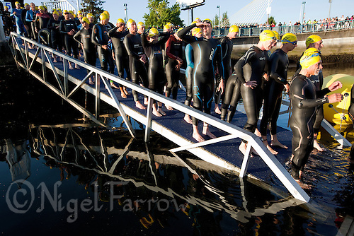25 JUN 2011 - PONTEVEDRA, ESP - Competitors wait for the start of their wave during the European Age Group Sprint Triathlon Championships (PHOTO (C) NIGEL FARROW)