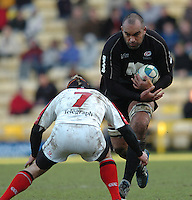 2005/06, Heineken Cup, 4th Rd, Saracens vs Ulster, Simon Raiwaliu attacking with the ball, sets himself for Neil McMillan challenge.  Vicarage Road, ENGLAND   © Peter Spurrier/Intersport Images - email images@intersport-images..