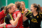 Mannheim, Germany, January 24: During the 1. Bundesliga Damen Hallensaison 2014/15 quarter-final hockey match between Mannheimer HC (white) and Harvestehuder THC (black) on January 24, 2015 at Irma-Roechling-Halle in Mannheim, Germany. Final score 2-3 (2-2). (Photo by Dirk Markgraf / www.265-images.com) *** Local caption *** (L-R) Anabel Herzsprung #8 of Harvestehuder THC, Leonie Hoffmann #tw of Harvestehuder THC, Laura Figura #14 of Harvestehuder THC