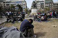 Pictured: A man rests on the ground in Victoria Square, Athens Monday 29 February 2016<br /> Re: Hundreds of migrants have been living in Victoria Square in central Athens Greece