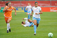 Cristiane (11) of the Chicago Red Stars is chased by Keeley Dowling (17) of Sky Blue FC. Sky Blue FC defeated the Chicago Red Stars 1-0 during a Women's Professional Soccer match at Yurcak Field in Piscataway, NJ, on June 17, 2009.