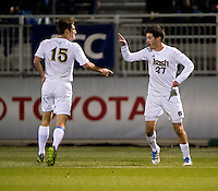 Patrick Hodan (27) of Virginia celebrates his goal with teammate Evan Panken (15) during the ACC tournament semifinals at the Maryland SoccerPlex in Boyds, MD.  Virginia advanced to the finals after tying Notre Dame, 3-3, in overtime and then defeating them on penalty kicks.