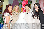 Sarah O'Connor shows her flower girl dress to Karina, Elaine and Deirdre Griffin Keel at the Southern Brides wedding fair in the Malton Hotel on Sunday.