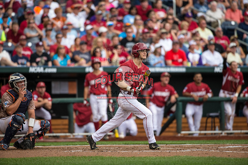 Andrew Benintendi (16) of the Arkansas Razorbacks bats and hits a home run during a game between the Virginia Cavaliers and Arkansas Razorbacks at TD Ameritrade Park on June 13, 2015 in Omaha, Nebraska. (Brace Hemmelgarn/Four Seam Images)