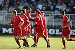 16 December 2007: Ohio State's Roger Espinoza (center) is congratulated by teammates after scoring the game's first goal. The Wake Forest University Demon Deacons defeated the Ohio State Buckeyes 2-1 at SAS Stadium in Cary, North Carolina in the NCAA Division I Mens College Cup championship game.