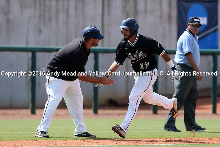04 June 2016: Nova Southeastern's Kevin Suarez (13) slaps hands with head coach Greg Brown (left) while rounding third after hitting a home run. The Nova Southeastern University Sharks played the Millersville University Marauders in Game 14 of the 2016 NCAA Division II College World Series  at Coleman Field at the USA Baseball National Training Complex in Cary, North Carolina. Nova Southeastern won the game 8-6 and clinched the NCAA Division II Baseball Championship.