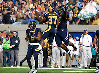 Viliami Moala of California celebrates with Robert Mullins in the air after making huge play during 115th Big Game against Stanford at Memorial Stadium in Berkeley, California on October 20th, 2012.  Stanford defeated California, 21-3.