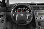Steering wheel view of a 2010 Toyota Camry LE