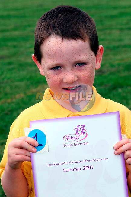 Declan Campbell who came 1st in the Junior Infants Boys race at Tullyallen Sports Day which was sponsered by Siucra...Pictured are the pupils from Tullyallen National School, one of the many schools selected to take part in the Suicra Schools Sports Day initiative. the first of it's kind nationwide, the Siucra School Soprts Day initiative saw Siucra organise and sponser the annual sports day in 1800 national schools nationwide and involving 250,000 pupils. Pupils received stickers, certificates, exercise sheets, sugessted games and finishing lines as part of the initiative..Picture: Paul Mohan/Newsfile..PICTURED SUPPLIED BY NEWSFILE LTD. ON BEHALF OF EDELMAN PR..NO REPRODUCTION FEE
