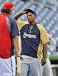 21 September 2012: Milwaukee Brewers outfielder Nyjer Morgan has a word with former teammate Michael Morse prior to a game against the Washington Nationals at Nationals Park in Washington, DC. The Brewers rallied in the 9th inning to defeat the Nationals 4-2 in the first game of their 4-game series. Mandatory Credit: Ed Wolfstein Photo
