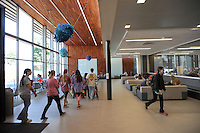 NWA Democrat-Gazette/ANDY SHUPE<br /> Students walk Tuesday, Sept. 15, 2015, through the entryway of the newly opened and dedicated Champions Hall on the University of Arkansas campus in Fayetteville. The $26.5 million, 62,000-square-foot structure is home to biology labs, general purpose classrooms, and the Math Resource and Teaching Center. The athletics department allocated a portion of the university's annual share of Southeastern Conference revenues to pay off the approximately $18 million in bonds that were issued to build the facility.