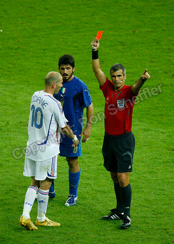 Jul 9, 2006; Berlin, GERMANY; France midfielder (10) Zinedine Zidane is issued the red card by referee Horacio Elizondo (Argentina) during extra time against Italy in the final of the 2006 FIFA World Cup at the Olympiastadion, Berlin. Italy defeated France 5-3 on penalty kicks following a 1-1 draw after extra time. Mandatory Credit: Ron Scheffler-US PRESSWIRE Copyright © Ron Scheffler