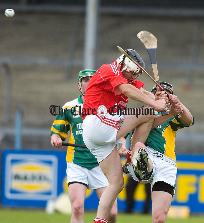 Crusheens Joe Meaney collides with Broadfords Pater O'Brienl during their Under 21 B Hurling Final at Cusack Park.Pic Arthur Ellis.