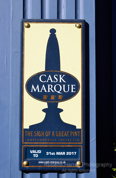 Cask Marque sign outside a pub - indicating outstanding real ale beer quality .