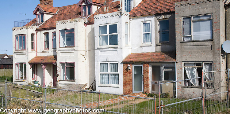 Houses abandoned and derelict awaiting demolition because of coastal erosion, Happisburgh, Norfolk, England