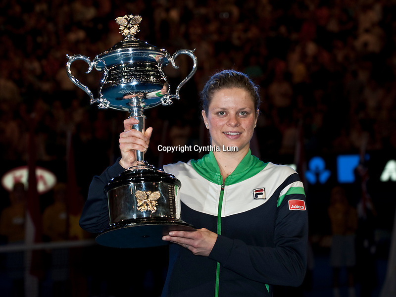 January 29, 2011.Kim Clijsters of Belgium, poses with trophy after defeating Na Li of China in the final at the Australian Open,Rod Laver Stadium, Melbourne Park, Melbourne, Australia.