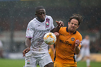 John Akinde of Barnet and Darren Jones of Newport County during the Sky Bet League 2 match between Newport County and Barnet at Rodney Parade, Newport, Wales on 3 September 2016. Photo by Mark  Hawkins / PRiME Media Images.