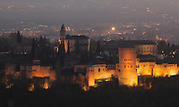 The Alhambra Palace illuminated at night, Granada, Andalusia, Southern Spain, with the Comares Tower, built in the 14th century under Muhammad V, the tallest tower in the Alhambra and housing the Hall of the Ambassadors, Nasrid Palaces and the Palace of Charles V in the background, built by Pedro Machuca in the 16th century. The Alhambra was begun in the 11th century as a castle, and in the 13th and 14th centuries served as the royal palace of the Nasrid sultans. The huge complex contains the Alcazaba, Nasrid palaces, gardens and Generalife. Picture by Manuel Cohen