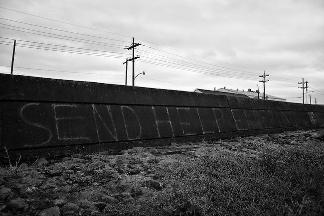 SEND HELP ELDERLY !!! Spray painted five years ago on the Industrial Canal floodwall in New Orleans.