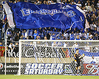 "With San Jose goalkeeper Pat Onstand in the foreground, Earthquakes' fan in the ""Casbah"" celebrate a San Jose goal during a 2005 MLS match between the San Jose Earthquakes and New England Revolution on April 2, 2005 at Spartan Stadium in San Jose, California.  The match ended in a 2-2 tie."
