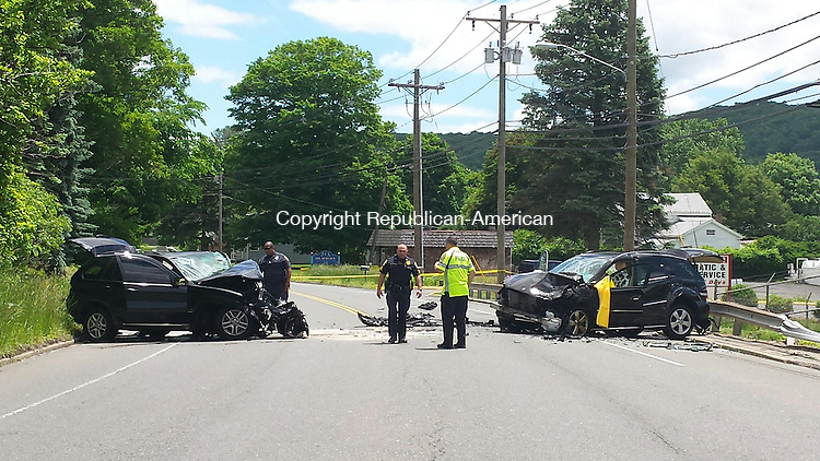 NAUGATUCK, CT June 06 2014-060614LW01 - Police investigate a head one collision between a BMW X5, left, and a Mercedes ML350 on New Haven Road in Naugatuck near the former Peter Paul factory property Friday morning.<br /> Laraine Weschler Republican-American