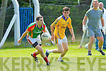Ger Hartnett (Mid Kerry) in action with Nigel O'Connor (Feale Rangers)  in the Coiste Chontae Chiarraí, Garvey's Super Valu,,2014 County Senior Football Championship -Round 3 at Ballylongford GAA grounds on Sunday.
