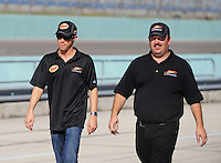 Nov. 21, 2009; Homestead, FL, USA; NASCAR Nationwide Series driver Kelly Bires (left) with crew chief Tony Eury Jr during qualifying for the Ford 300 at Homestead Miami Speedway. Mandatory Credit: Mark J. Rebilas-