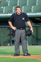 Home plate umpire Garrett Corl between innings of the South Atlantic League game between the Asheville Tourists and the Kannapolis Intimidators at Fieldcrest Cannon Stadium July 26, 2010, in Kannapolis, North Carolina.  Photo by Brian Westerholt / Four Seam Images