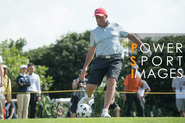 Gary McAllister kicks a football at the 14th hole during the World Celebrity Pro-Am 2016 Mission Hills China Golf Tournament on 22 October 2016, in Haikou, China. Photo by Weixiang Lim / Power Sport Images