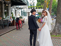 A Bride and Groom and everyday life in the streets of Hanoi, Vietnam